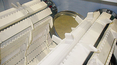 Continuous conveyor through feed machines